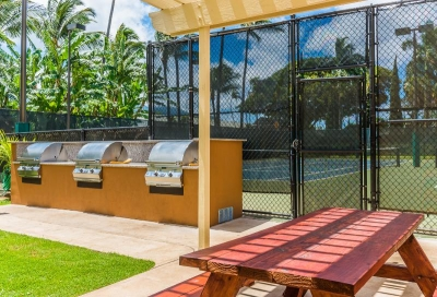Outdoor barbecues and tennis facility.