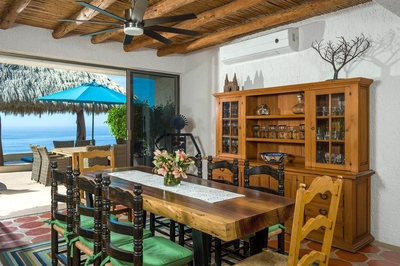 Seat up to 8 guests on the rustic dining table at Villa Helena