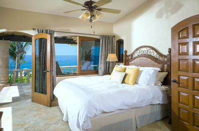 Enjoy a beautiful ocean or garden view from one of the four bedrooms at Villa Punta Serena