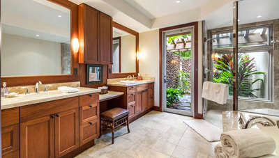 Master bath with dual sinks, oversize soaking tub, separate shower, and outdoor shower garden.