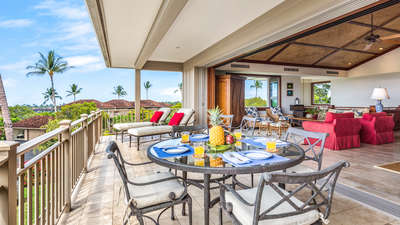 View of lanai with loungers and dining area, into great room.