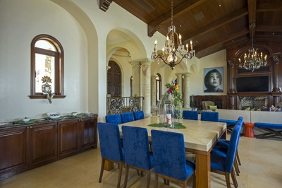Seat up to 12 guests at the villa's opulent formal dining table