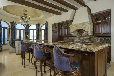Rich wood beams along the kitchen ceiling perfectly complete this ornate space.