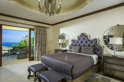 Plush beds show of the sophisticated style that runs through each room of Villa Bella Laura.