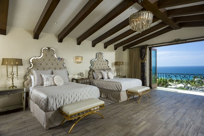 With two queen beds in this room, more guests can enjoy an elegant experience at Villa Bella Laura.