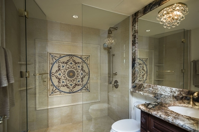 Admire the dazzling lights and patterns running through the villa bathrooms