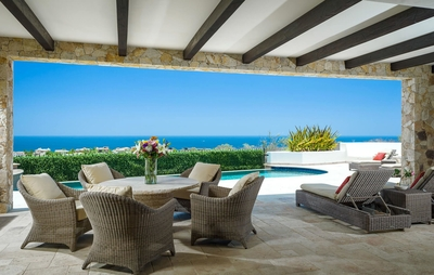 Take refuge from the Cabo sun under the covered portion of the terrace