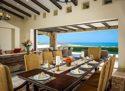 Comfortably seat 8 at Casa Kay's formal dining area which includes an ocean view from the large wind