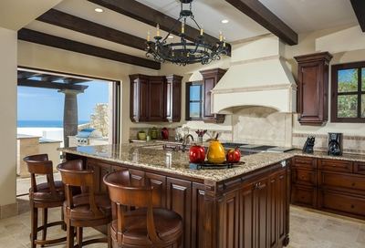 Plenty of cooking and entertaining space is available in the stunning gourmet kitchen that opens out