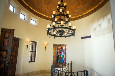 Be merzmerized by the traditional Spanish style candelabra chandeliers that are featured throughout