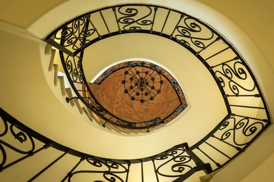 Become entranced with Casa Kay's winding staircase and its intricately designed railings.
