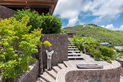 Outdoors: Tropical and lush garden, and dramatic ocean views from every parts of the property