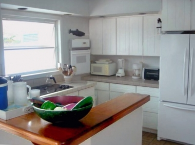 Kitchen has all appliances.