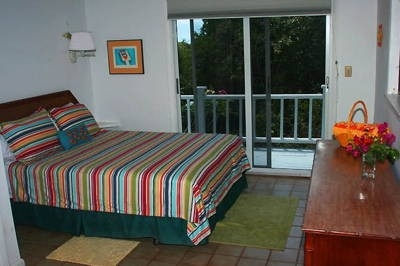 Queen bedroom with slider to private deck area.