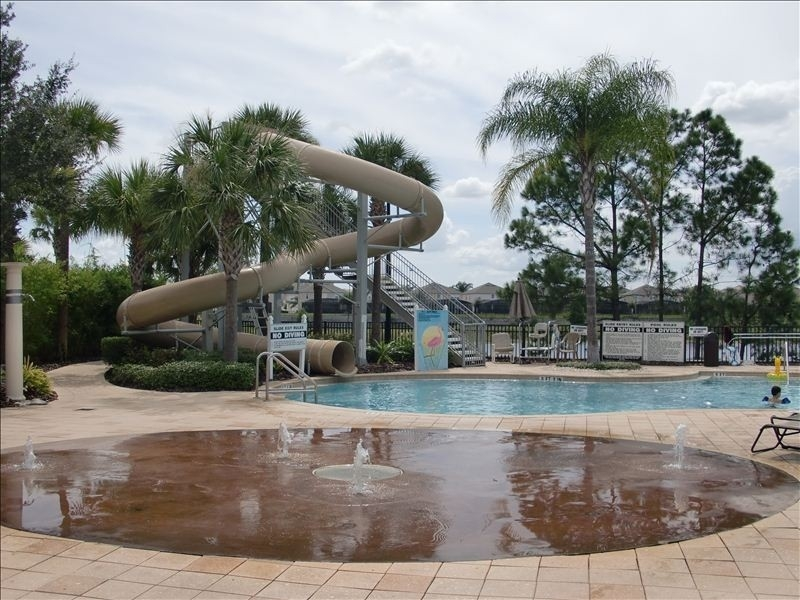 Luxury pool home in windsor hills kissimmee in disney orlando area for Windsor swimming pool with slides