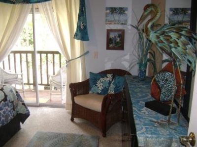 Guest bedroom with private lanai & plumerias