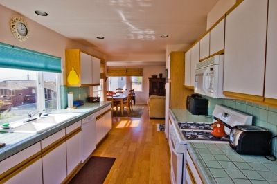 Sunlit and fully equipped kitchen