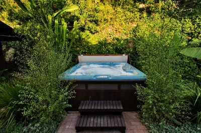 Relax in the private hot tub with seating for 6
