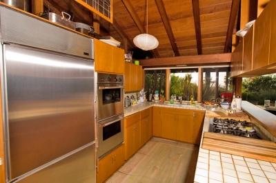 Fully equipped kitchen with modern stainless steel appliances